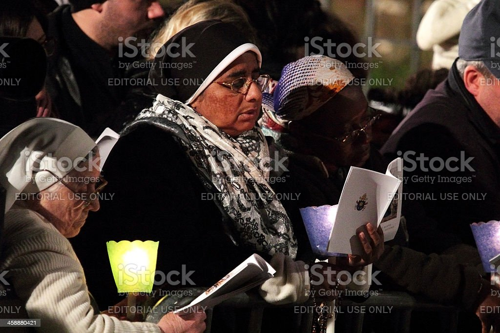 Women during Stations of the Cross chaired by Pope Francis stock photo