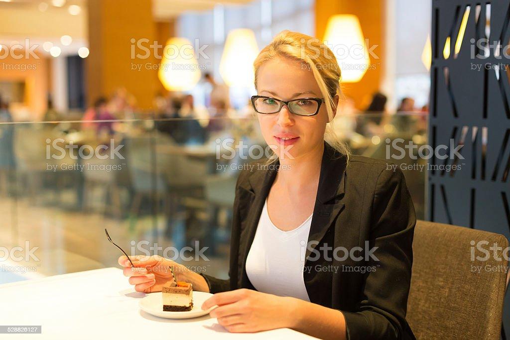 Women eating dessert in fancy restaurant. stock photo