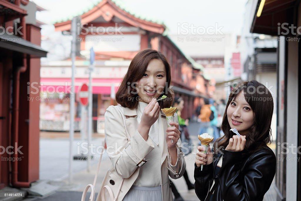 Women eating Ice cream on vacation travel stock photo