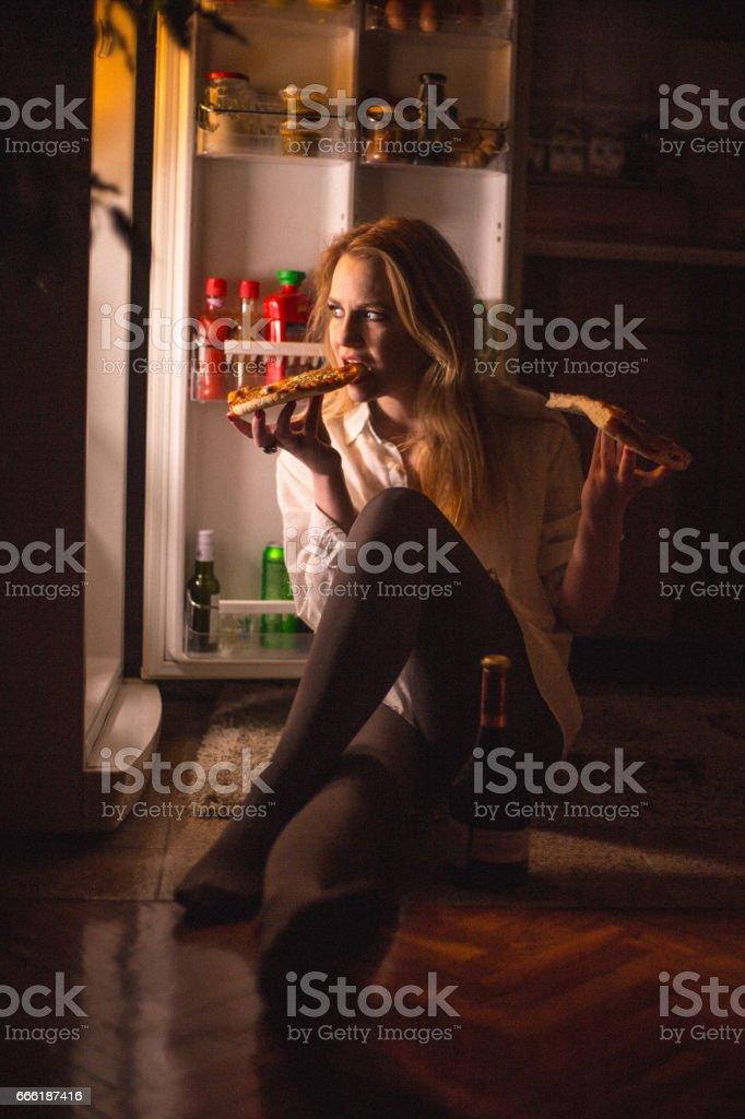 Women eating pizza late night stock photo