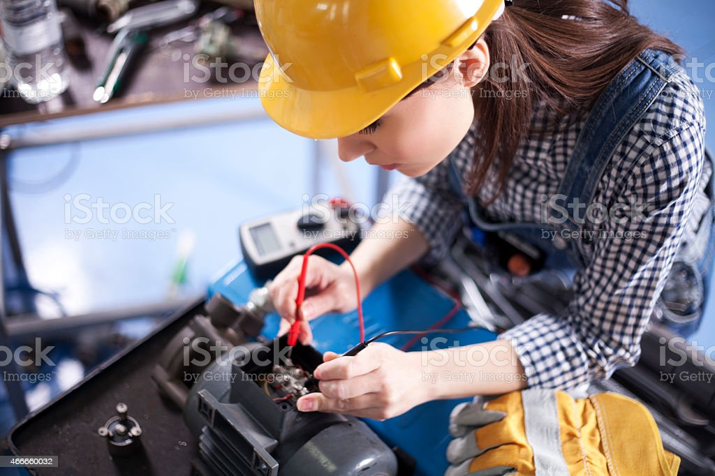 Women electrician working. stock photo