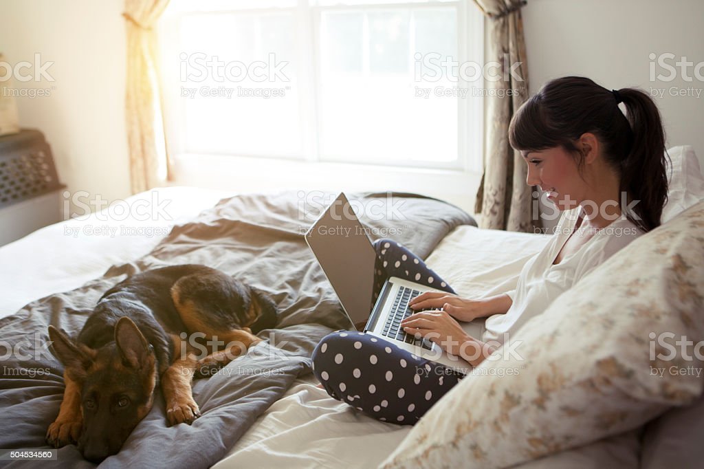 Women enjoy at home with her dog. stock photo