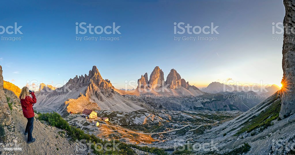 Women enjoy the view  at Tre Cime and take pictures stock photo