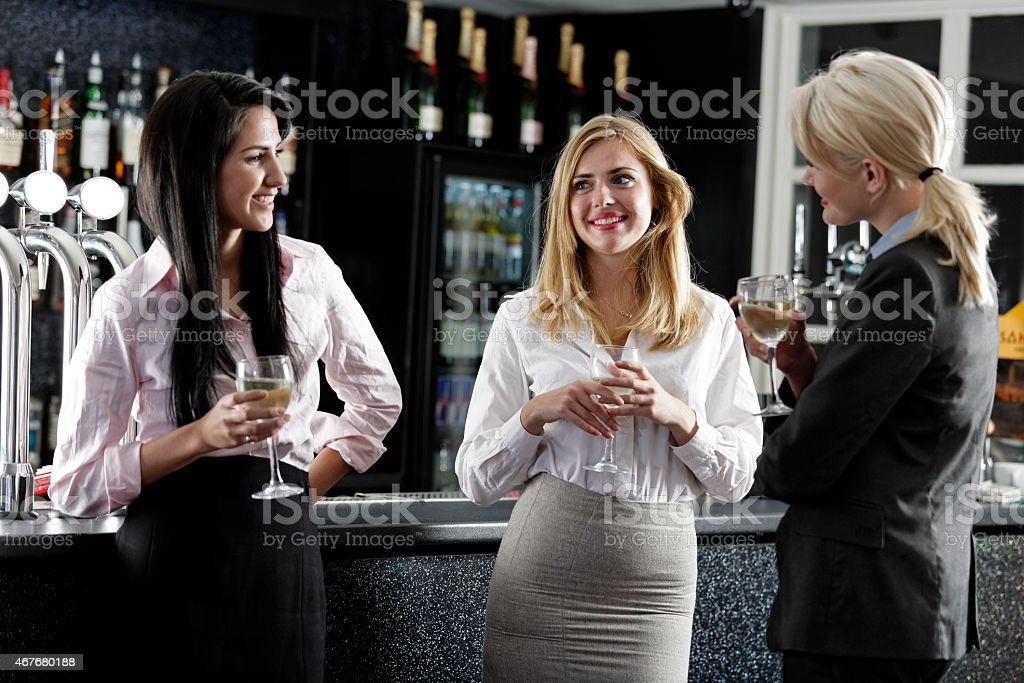 Women enjoying a glass of wine stock photo