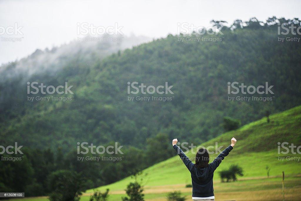 Women enjoying nature in meadow. stock photo