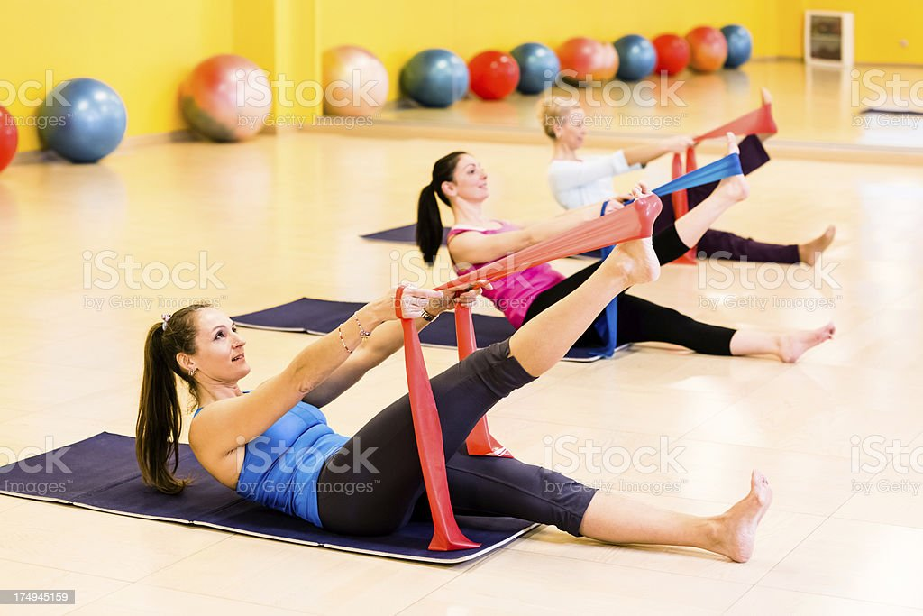 Women exercises pilates yoga resistance with band rubber royalty-free stock photo
