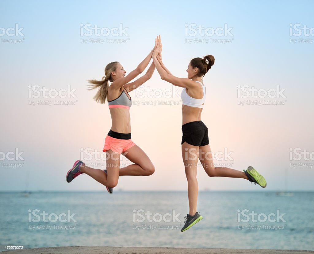 Women exercising at Sunset on the Beach, California, USA stock photo
