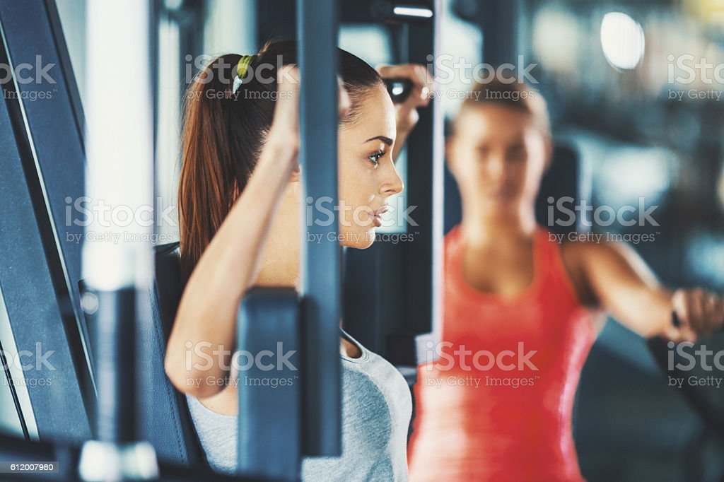 Women exercising in gym. stock photo