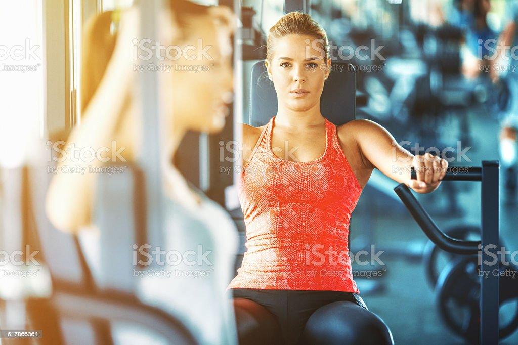 Women exercising in gym. stock photo