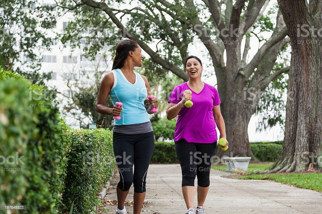 Women exercising in park stock photo
