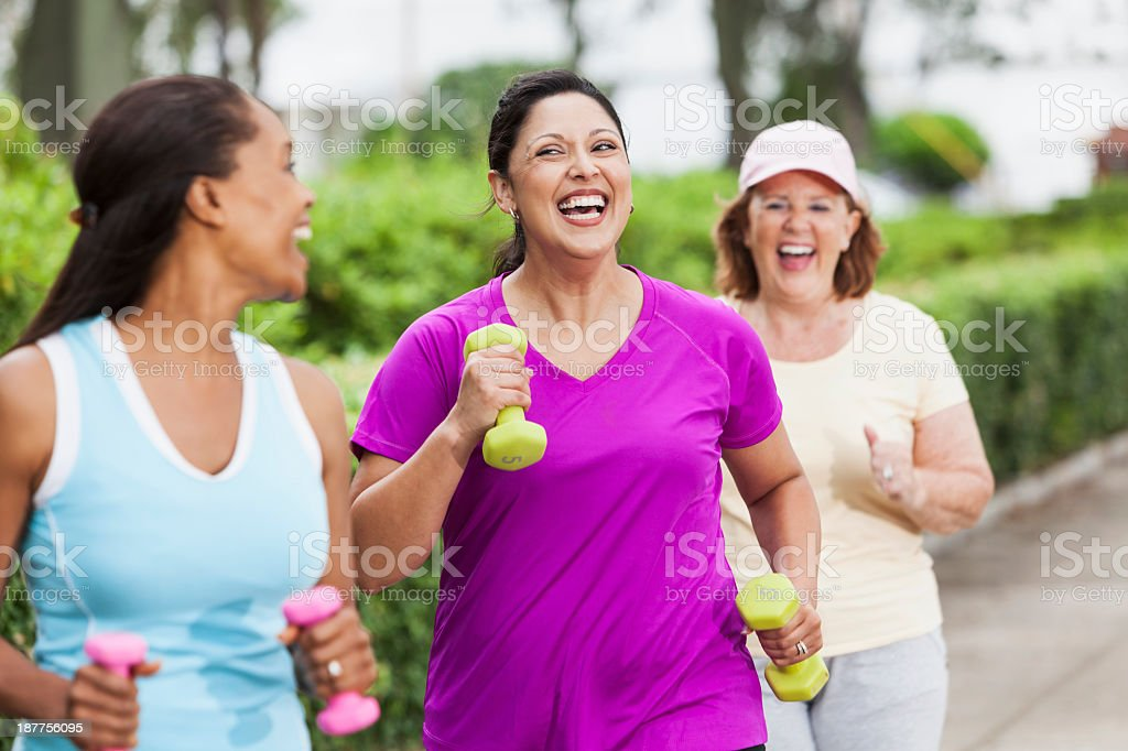 Women exercising in park stock photo