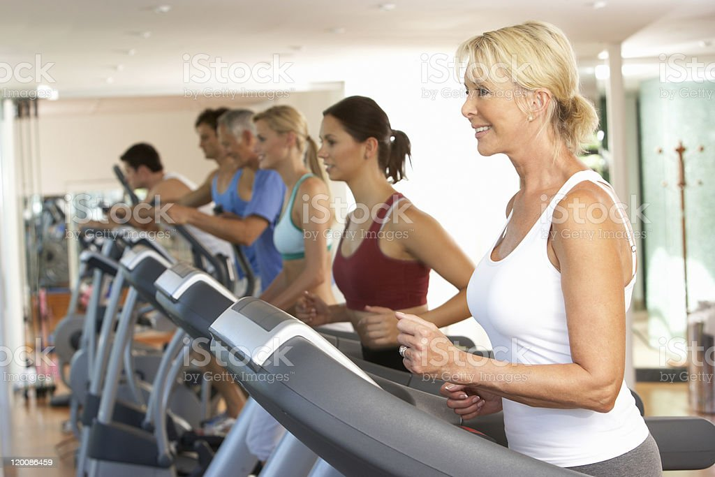 Women exercising on treadmills at the gym royalty-free stock photo