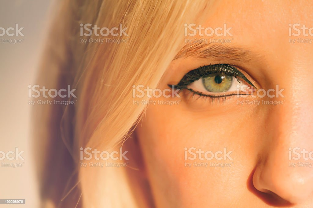 women eyes green stock photo
