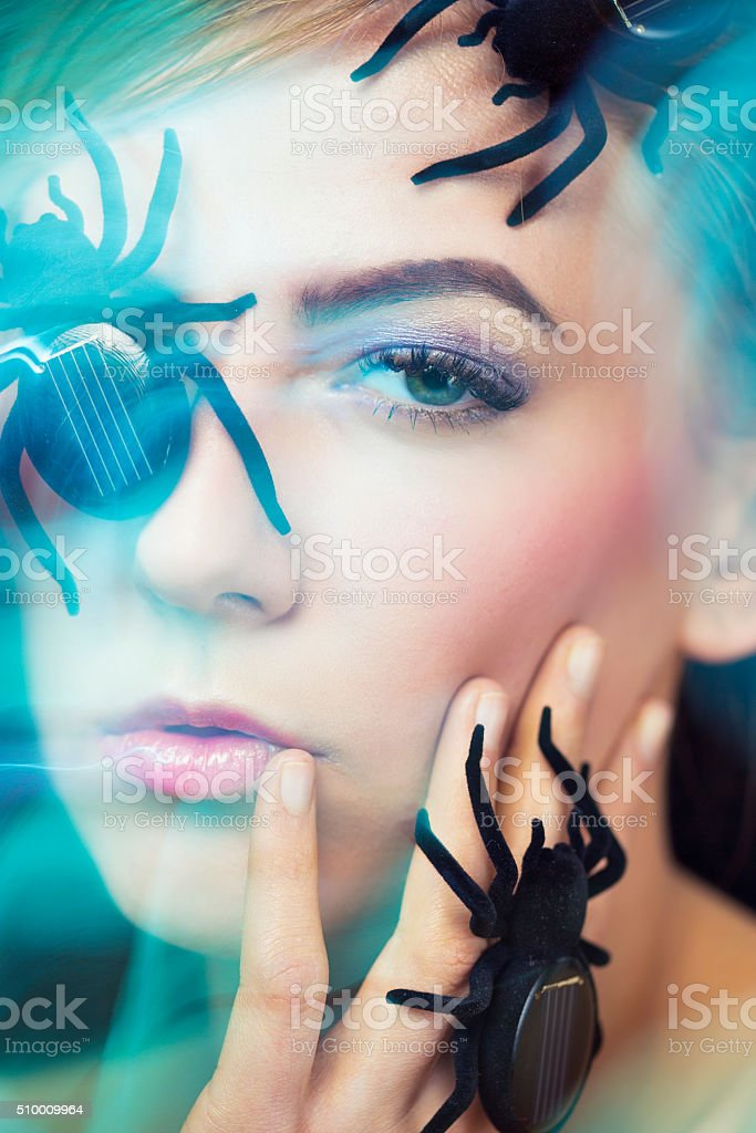 Women Face Covered with Small Solar Spiders stock photo