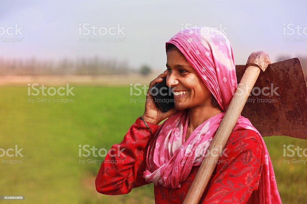 Women farmer talking on smart phone stock photo