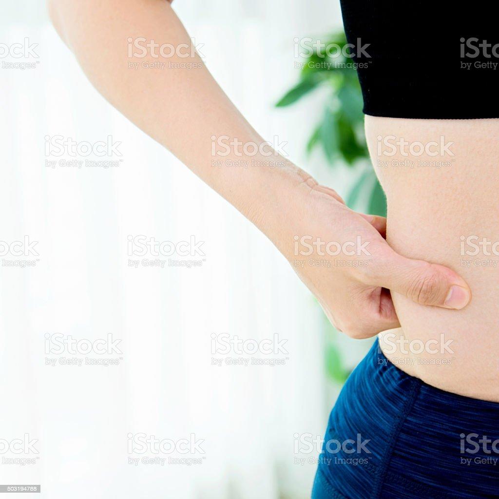 Women fat measuring stock photo