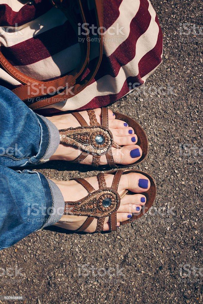 Women feet in summer flats stock photo