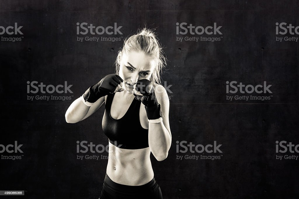 Women Fighter in a Stand Off In Black and White stock photo