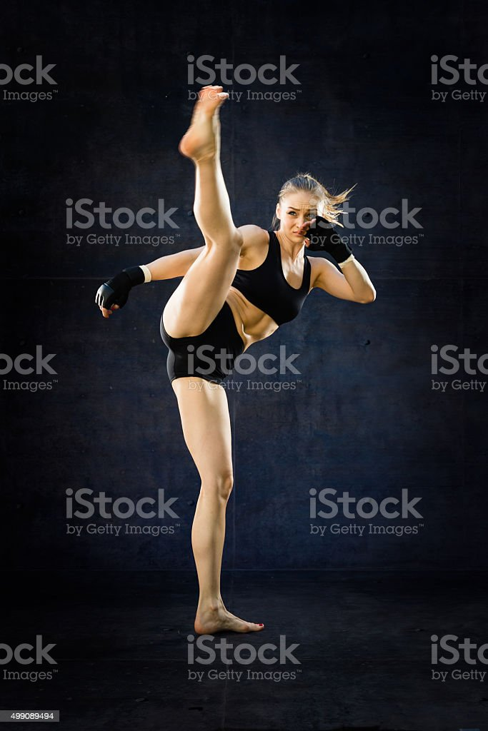 Women Fighter Kicking stock photo