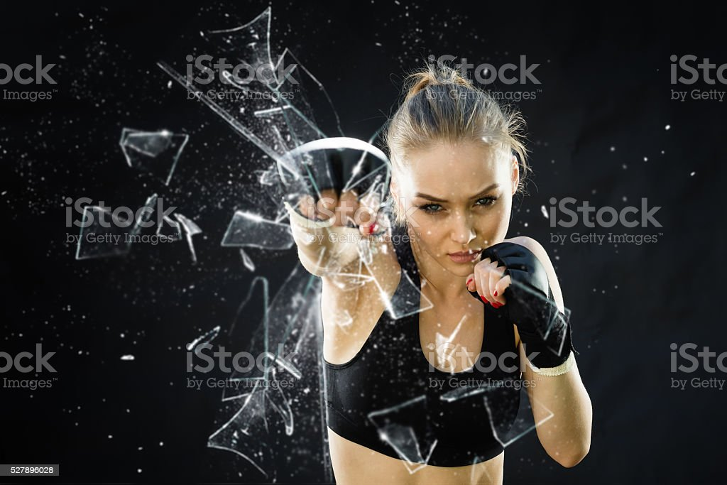 Women Fighter Punching Close Up Glass Shattering royalty-free stock photo