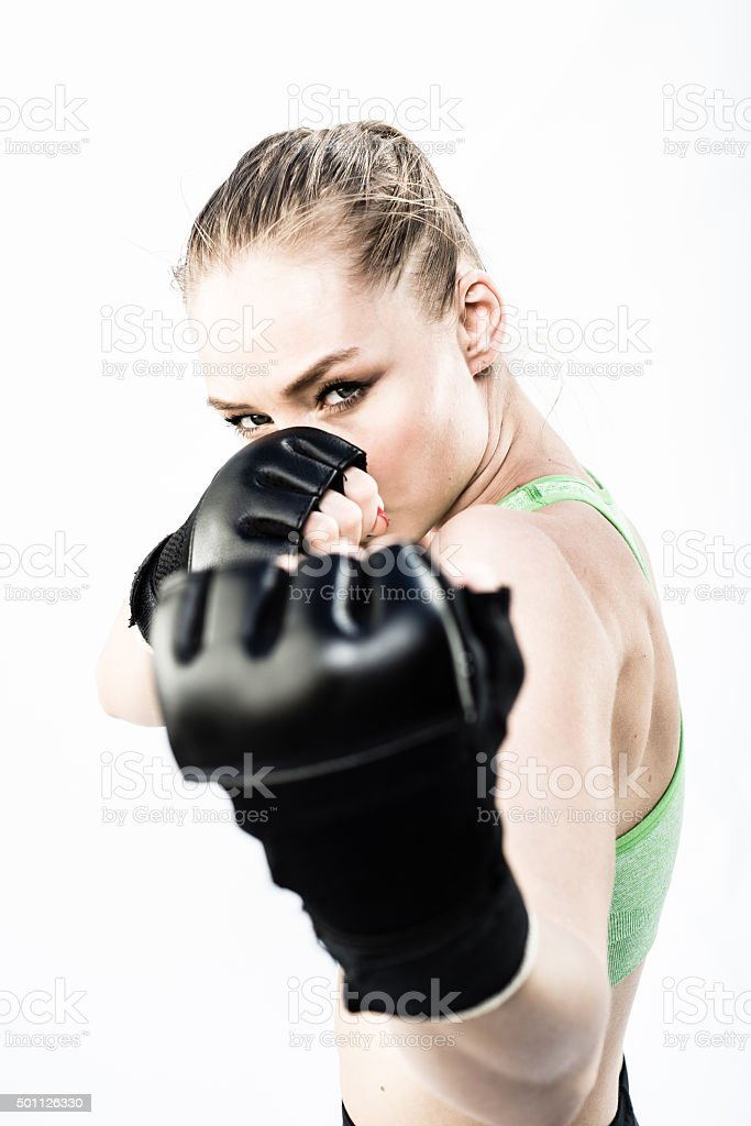 Women Fighter Punching White Background stock photo