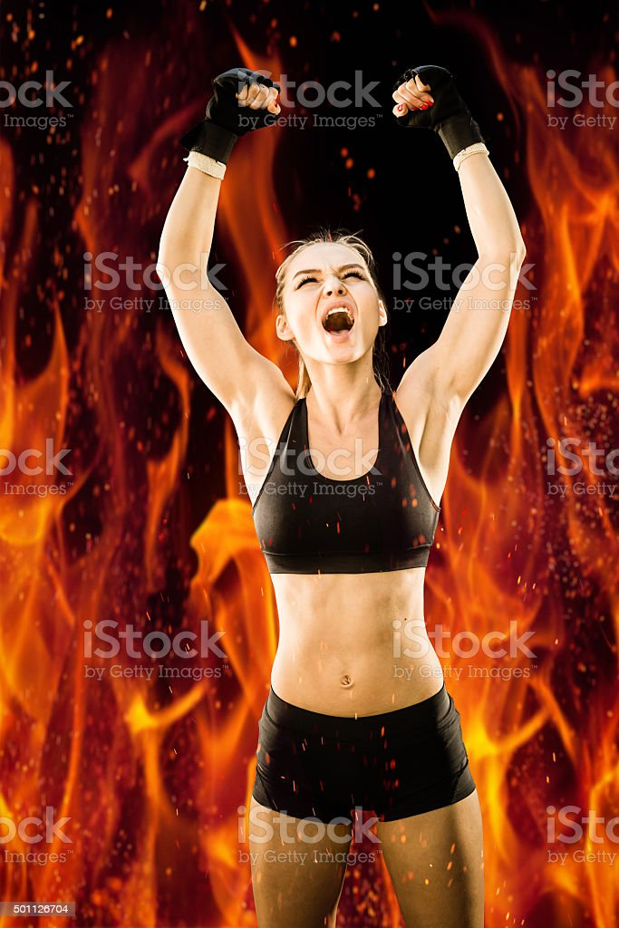 Women Fighter Winner With Hands Raised High Screaming stock photo
