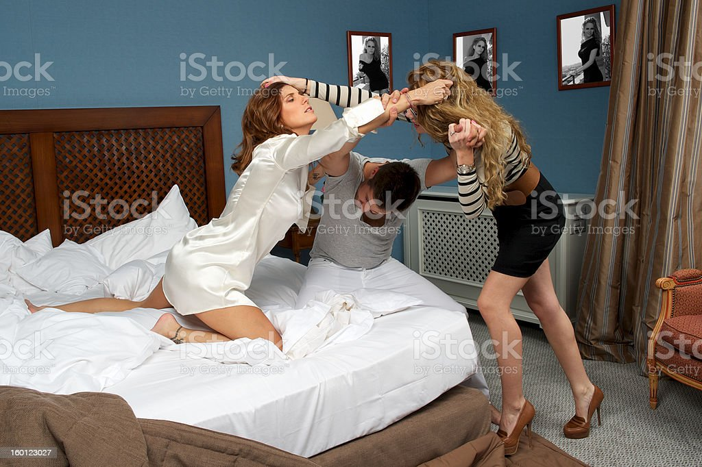 Women fighting and pulling on hair royalty-free stock photo