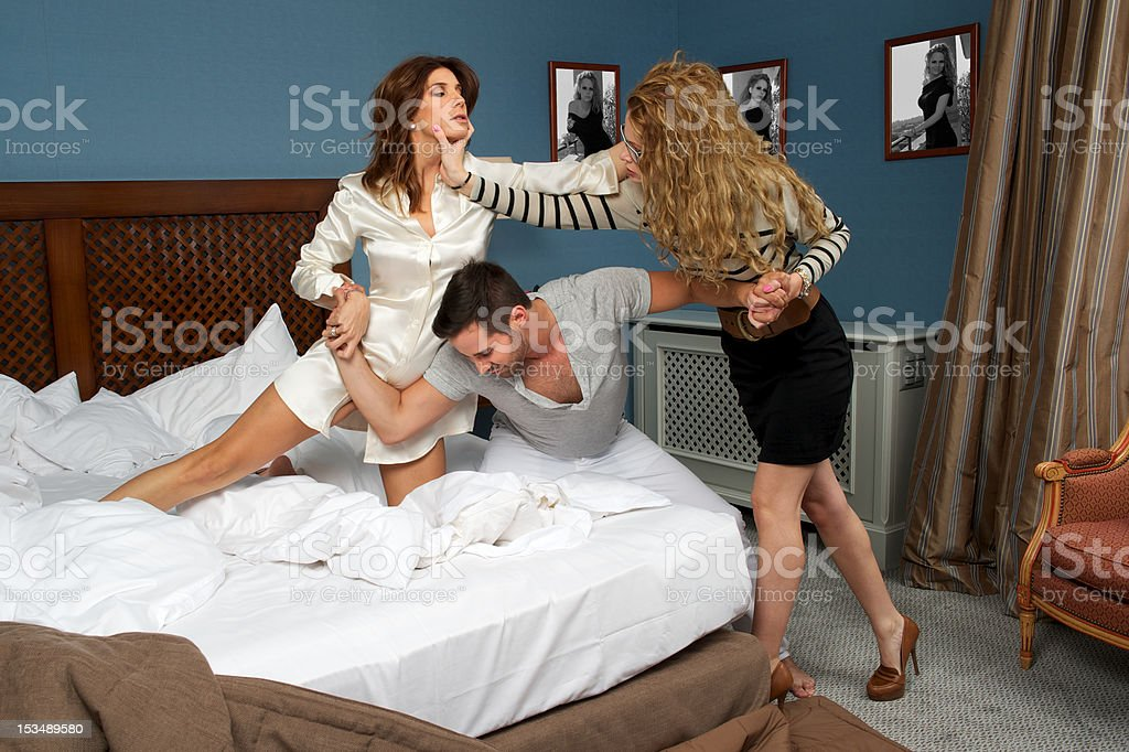 Women fighting for a boy royalty-free stock photo