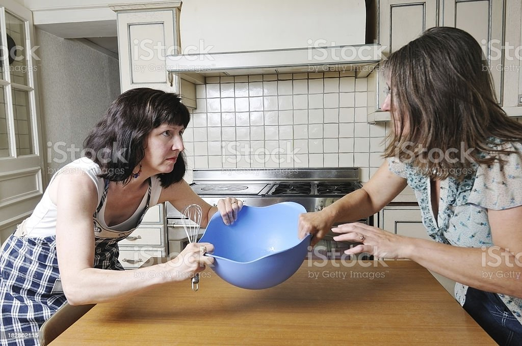 women fighting in the kitchen stock photo