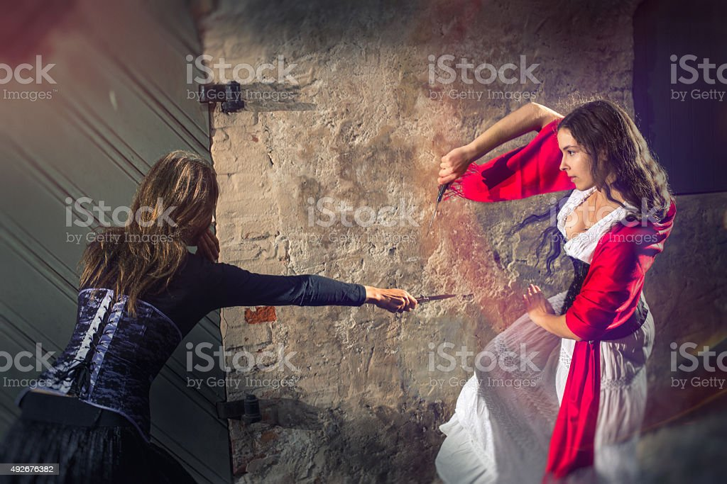Women fighting with knives stock photo