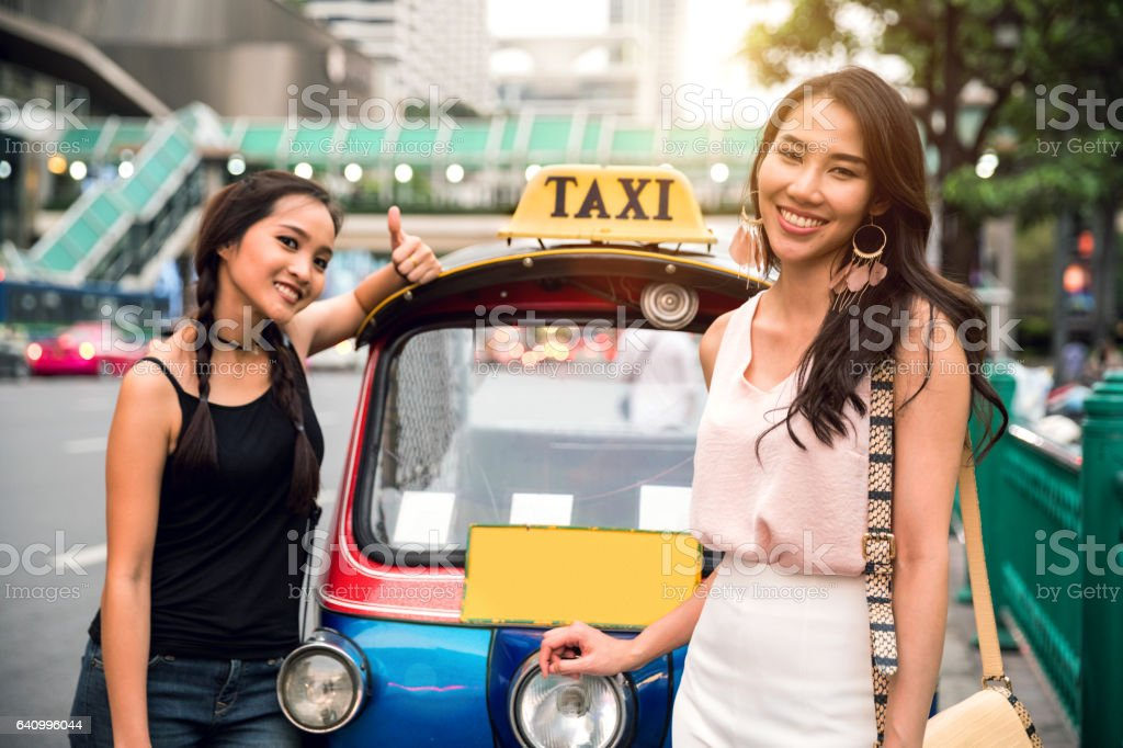 Women friends in Bangkok excited to discover the city stock photo