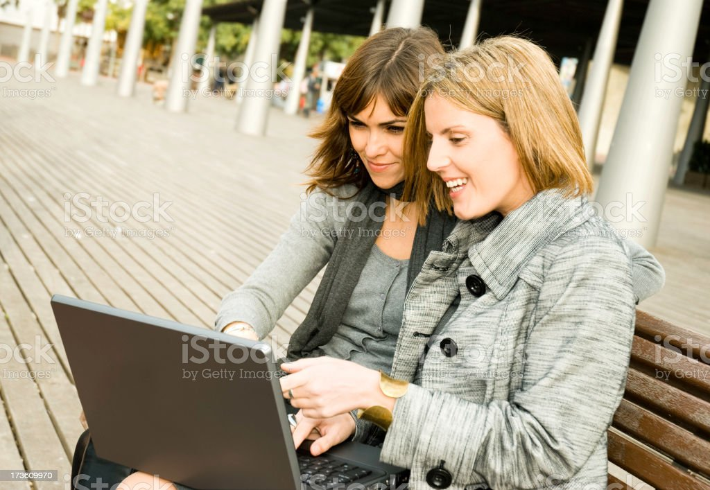 Women friends with laptop royalty-free stock photo