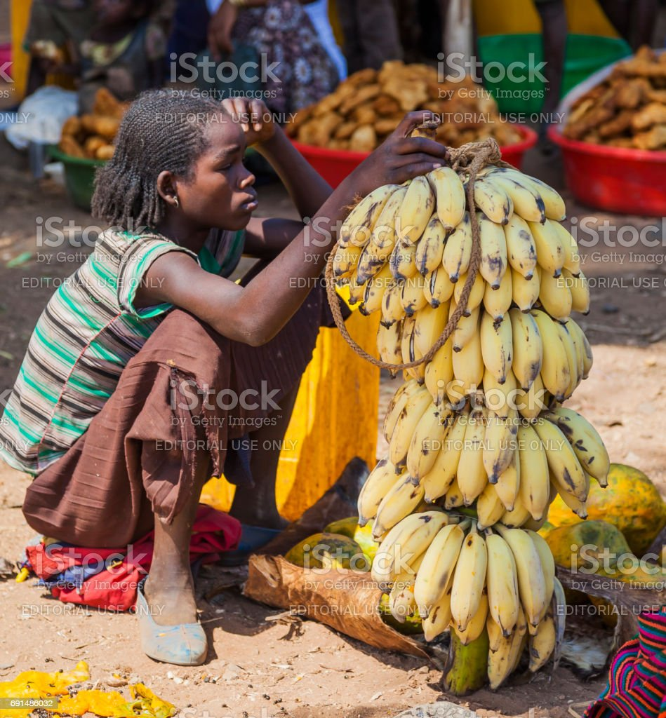 Women from Konso tribal area sell bananas at local village market. Omo Valley. Ethiopia stock photo