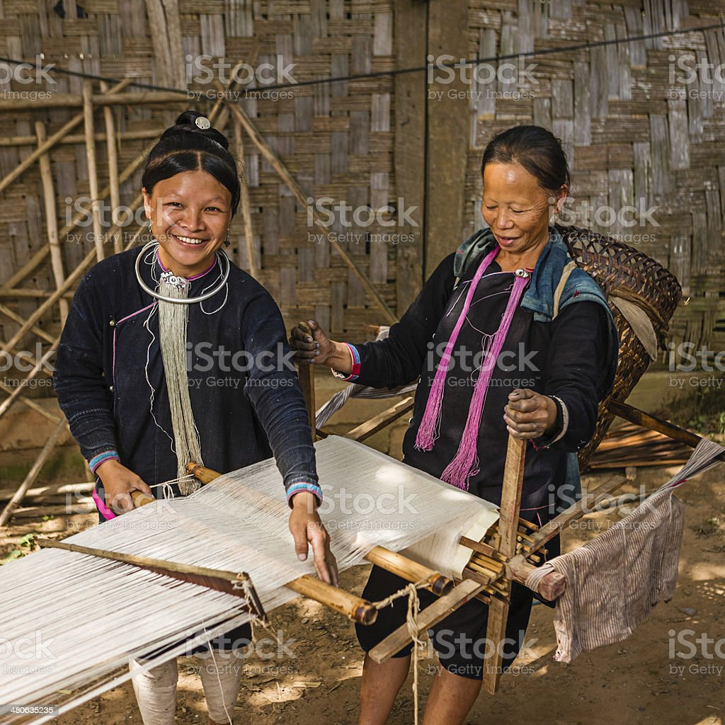 Women from the Lantan hill tribe working with loom stock photo