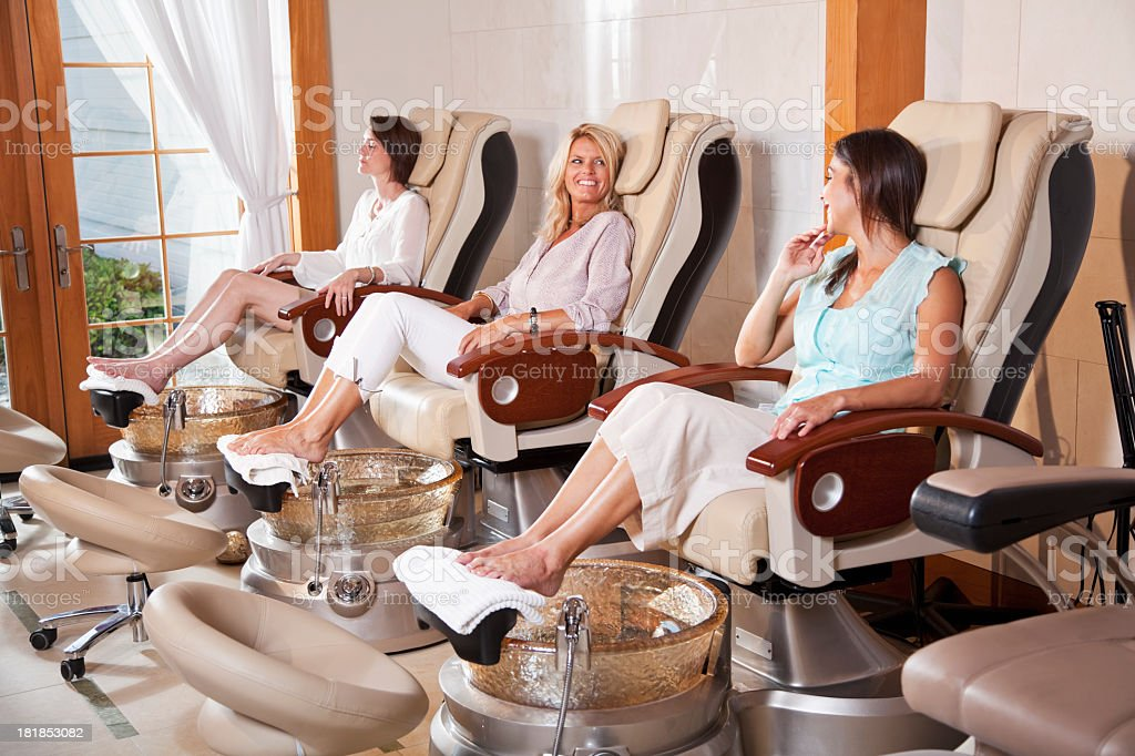 Women getting pedicures stock photo