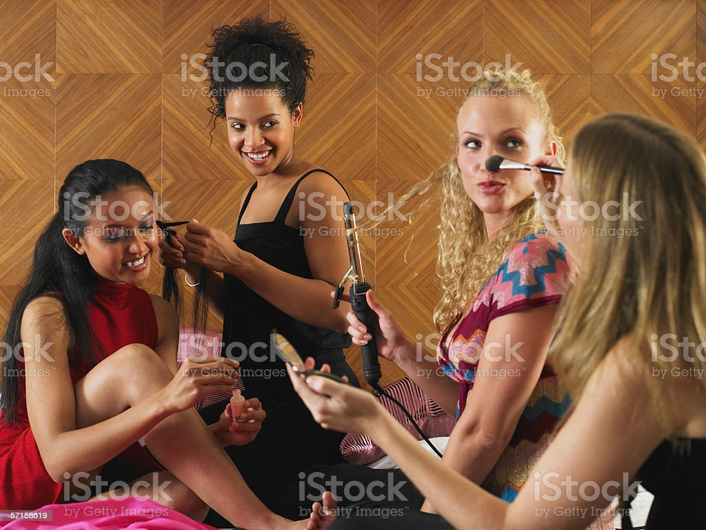 Women getting ready to go out stock photo