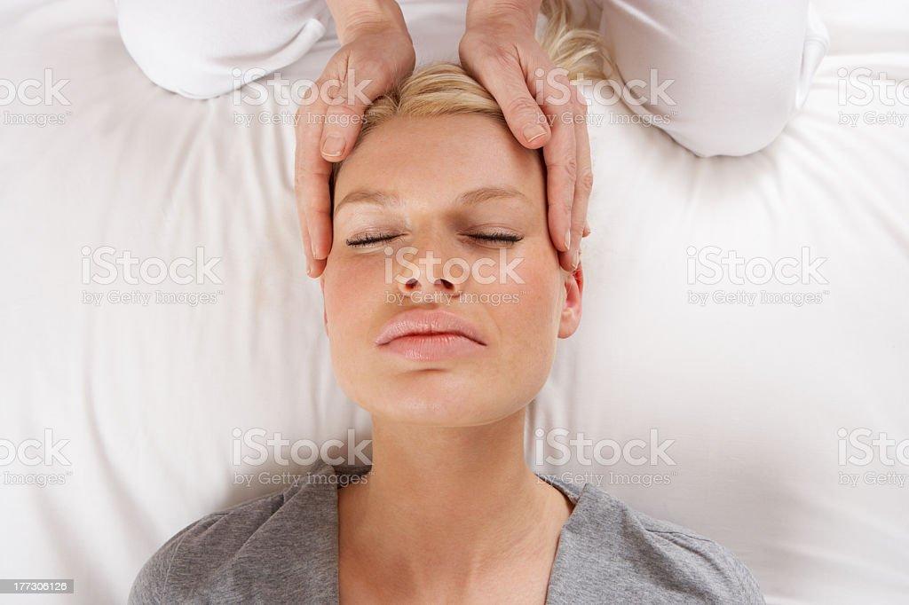 Women getting shiatsu massage to her head royalty-free stock photo