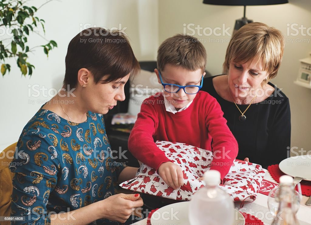 Women Giving Gift to a Child stock photo