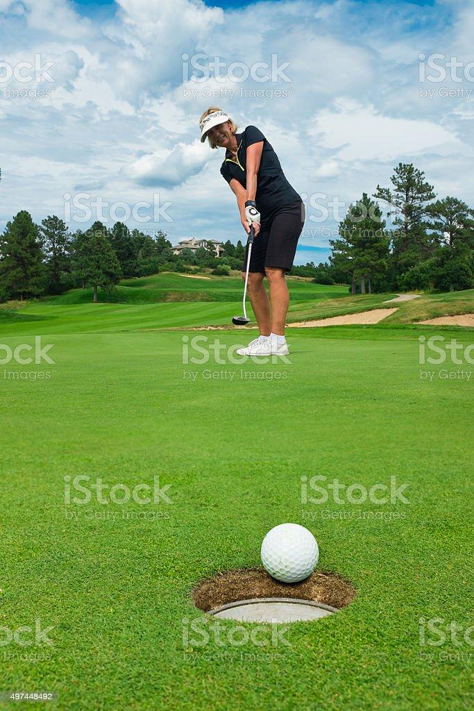 Women Golfer Putting stock photo
