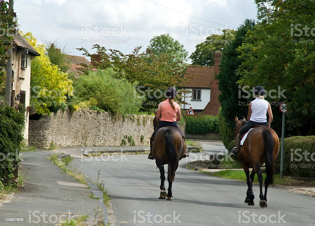 Women Hacking out on two horses stock photo