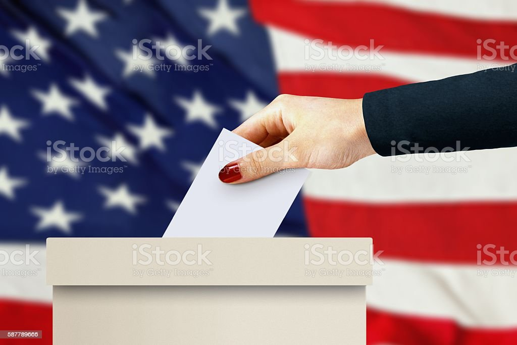 women hand casting a vote stock photo