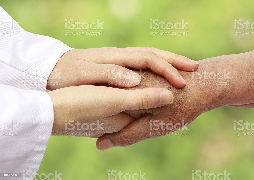 Women hand helping senior patient royalty-free stock photo