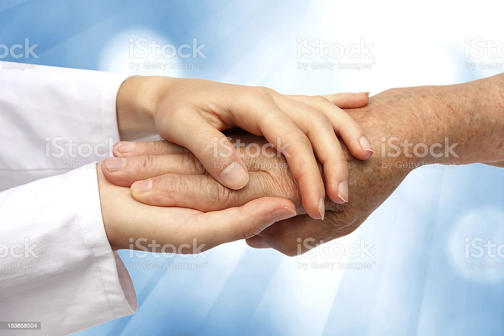 Women hand helping senior stock photo