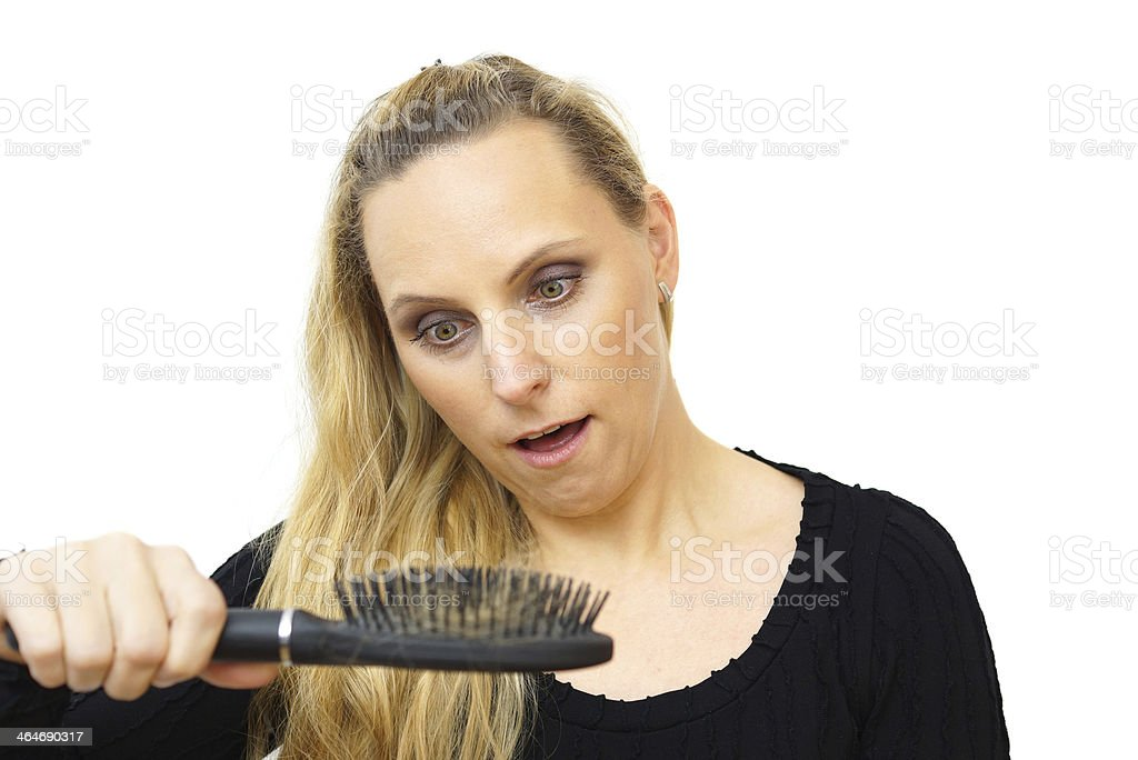 women hand holding loss hair comb stock photo