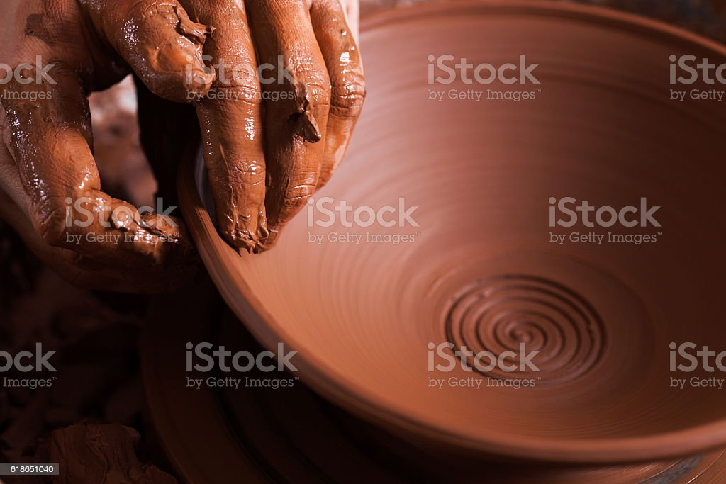 Women hands. Potter at work. Creating dishes. Potter's wheel. Di stock photo