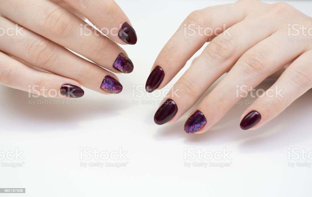 Women hands with beautiful manicure. Natural nails and gel polish.
