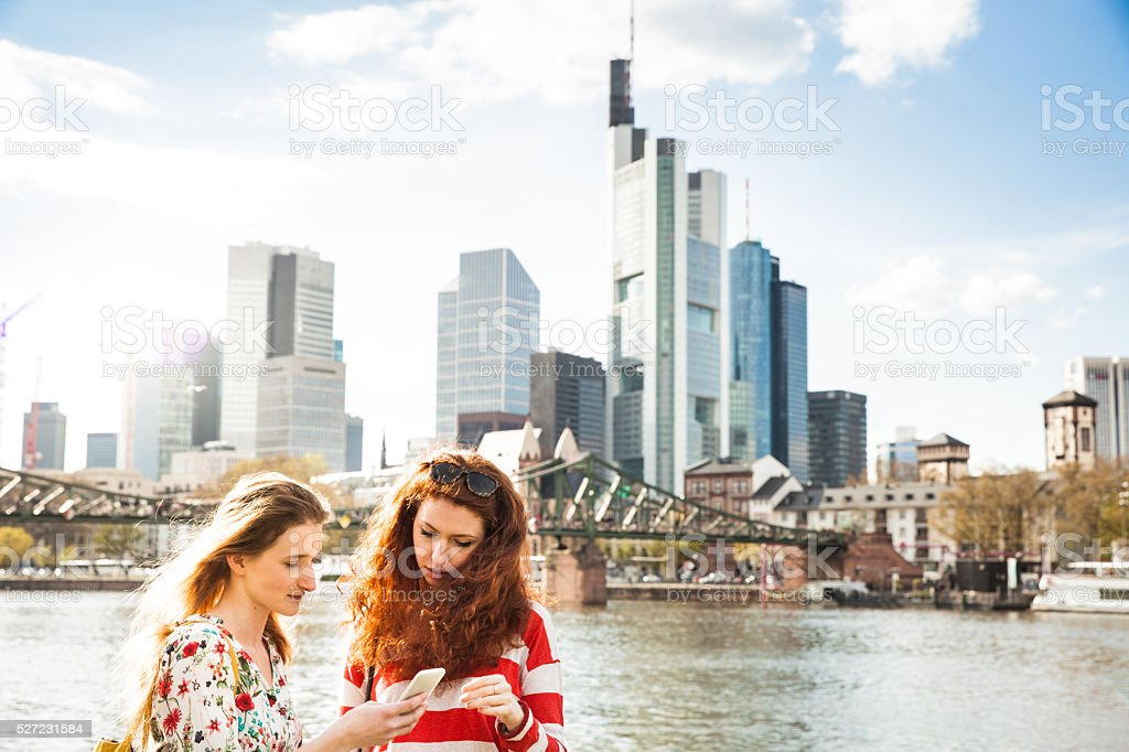 Women hanging out in the city during spring stock photo