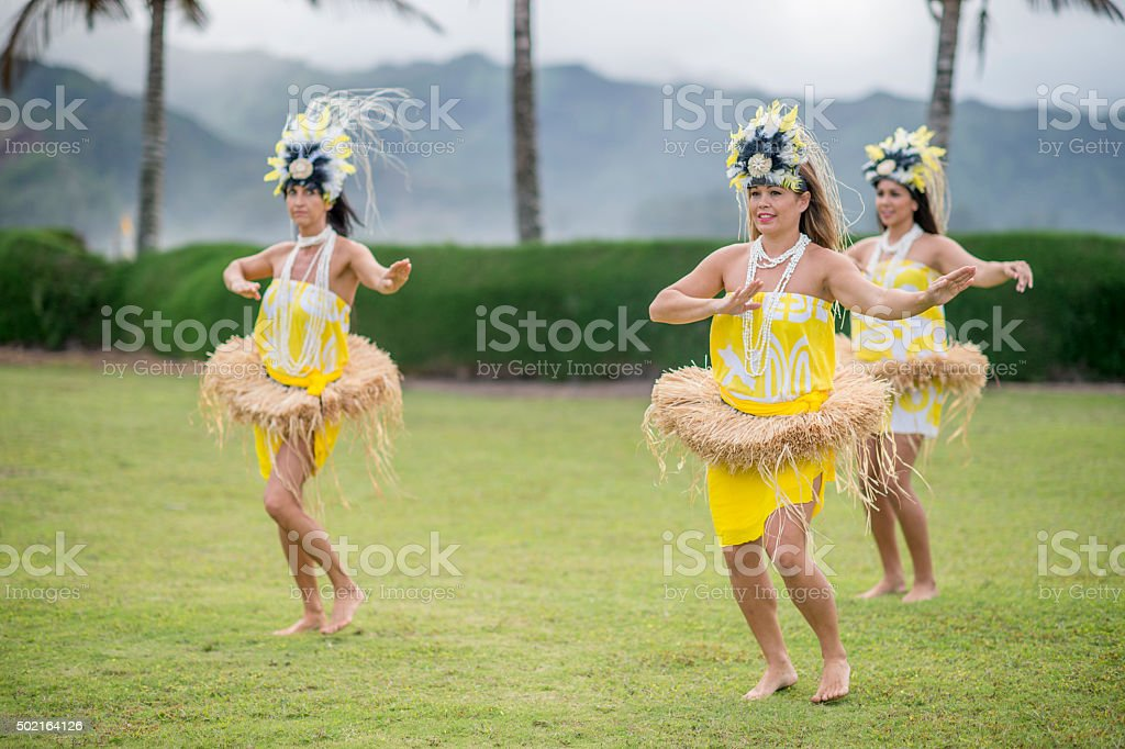 Women Happily Performing at a Luau stock photo