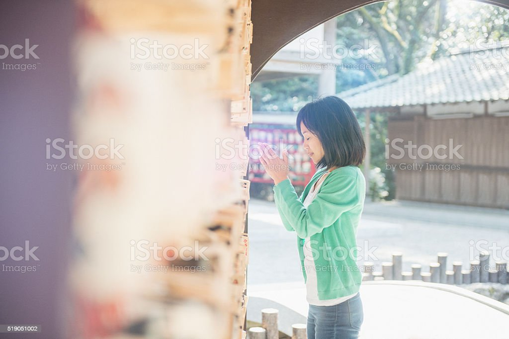 Women have a Buddhist prayer in a temple stock photo
