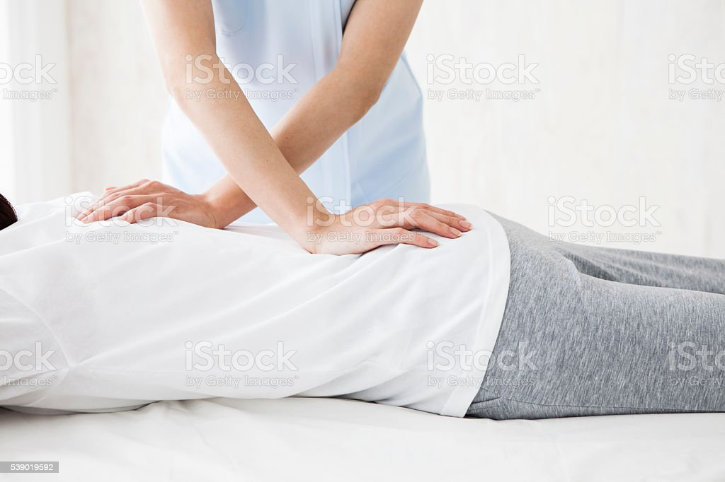 Women have been massaging the back at the salon stock photo
